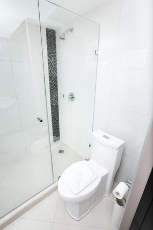 White toilet in a bathroom tiled interior   Stock Photo