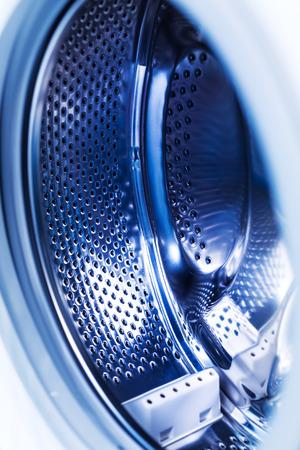Detail of washing machine at bathroom, stainless drum inside, closeup, nobody Stock Photo