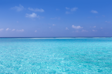 Crystal pure azure water in Indian ocean with coral reefs, beautiful maldivian nature with seascape Stock Photo