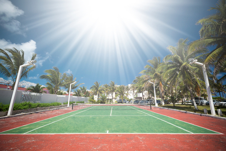 Outdoor empty tennis court at tropical destinations  Stock Photo