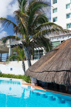 Mexico, Cancun - 16 January 2016: BelleVue Beach Paradise resort with swimming pool near sandy coastline