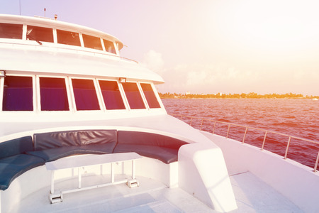 Vacations on luxury yacht in tropical sea. Travel around the world