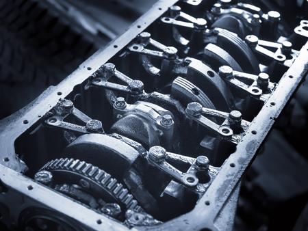 Open car engine, closeup. Automobile service, Nobody. Overhaul servicing of vehicle. Blue tone
