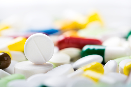 A lot of different medicine pills and capsules. Medical background