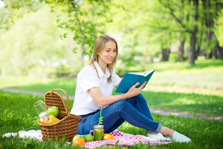 Young woman in park outside at sunny day, enjoying summertime Stock Photo