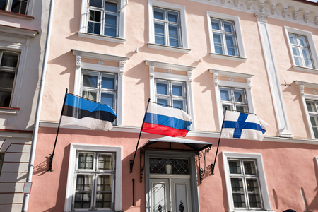 Estonian, Russian and Finnish Flags on streets walls of houses at old Town, Tallinn, Estonia Stock Photo