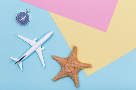 Travel and Summer Holidays objects on pastel color paper texture, flat lay Stock Photo