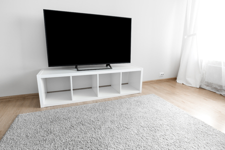 Lcd tv on white shef at modern room interior with nobody