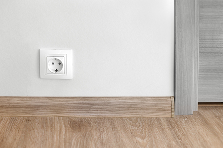 Electric socket mounted on wall at modern flat, nobody Stock Photo