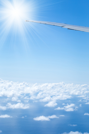 Aerial view from plane on wing and clouds, travel concept