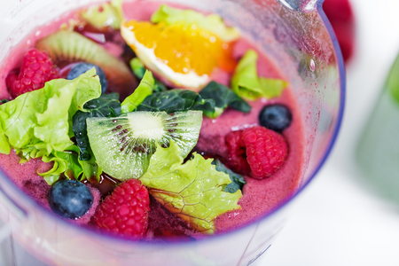 Fresh raw berries and fruits in blender, top view, preparing detox smoothie, no people Stock Photo
