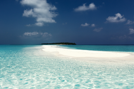 Maldivian sandbank in Indian ocean, white sandy coast with crystal azure color water, toned image Stock Photo