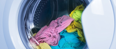 Process of cleaning colour cloth in washing machine,  closeup, nobody