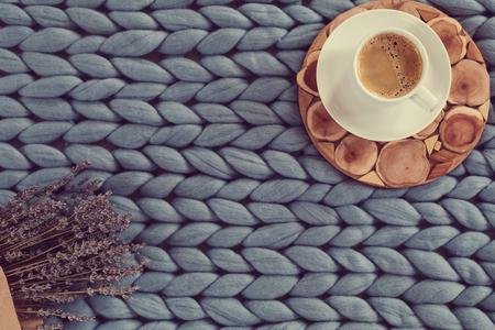 Autumn season concept of cozy home, hot coffee on merino plaid, top view, copyspace