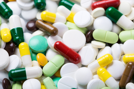Medicine pills and capsules. Medical background Stock Photo