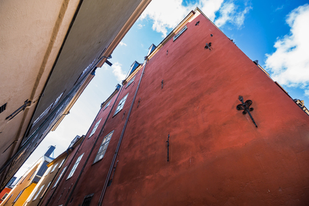 View from bottom on houses at the street of Old Town in Tallinn, historical architecture of Estonia Stock Photo