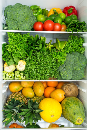 Opened fridge full of fresh colorful fruits and vegetables, healthy nutrition concept, nobody Reklamní fotografie