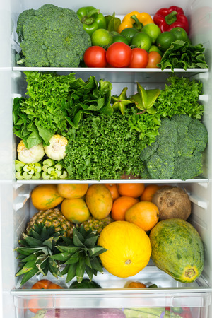 Opened fridge full of fresh colorful fruits and vegetables, healthy nutrition concept, nobody Stock fotó