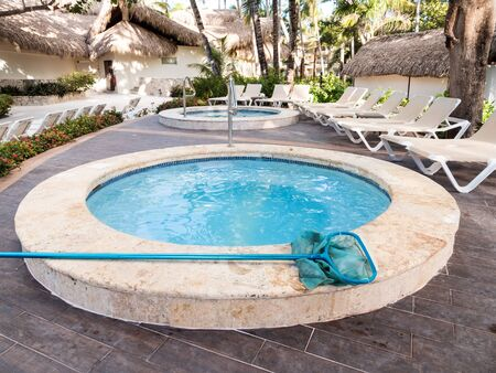 Bavaro, Punta Cana, Dominican Republic - 2 December 2018: Cleaning Jacuzzi. Maintenance of pool at resort