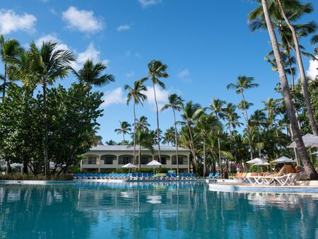 Bavaro, Punta Cana, Dominican Republic - 2 December 2018: Poolside with sun umbrellas and sun beds at Sunscape Dominican Beach Punta Cana resort