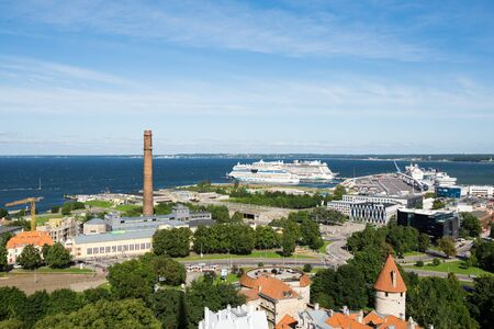 TALLINN, ESTONIA - SEPTEMBER 4, 2017: Aerial panoramic view of Tallinn old town city center and port with cruise ships at sunny day.