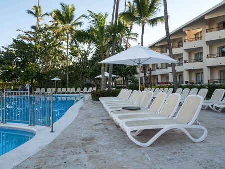 Bavaro, Punta Cana, Dominican Republic - 30 November 2018: Poolside with swimming pool, sun umbrellas and sun beds at Sunscape Dominican Beach Punta Cana resort Editorial