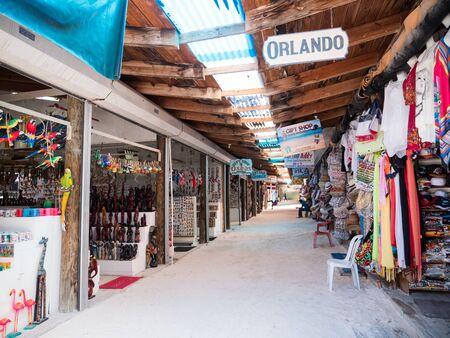 BAVARO, PUNTA CANA, DOMINICAN REPUBLIC - 4 FEBRUARY 2019: Souvenirs shops with different goods on beach Bibijagua Editorial