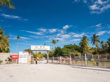 BAVARO, PUNTA CANA, DOMINICAN REPUBLIC - 4 FEBRUARY 2019: Entrance with toll-bar to Playa and Plaza Artesanal Bibijagua
