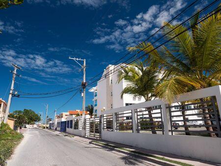 BAVARO, PUNTA CANA, DOMINICAN REPUBLIC - 4 FEBRUARY 2019: Retiro Bavaro apart hotel. Traditional caribbean building with gate and fence