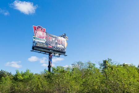 BAVARO, PUNTA CANA, DOMINICAN REPUBLIC - 19 JANUARY 2019: Coco Bongo advertisement signboard at the road