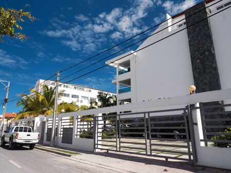 BAVARO, PUNTA CANA, DOMINICAN REPUBLIC - 4 FEBRUARY 2019: Entrance to Retiro Bavaro apart hotel. Traditional caribbean building with gate and fence Editorial