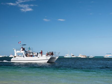 BAVARO, PUNTA CANA, DOMINICAN REPUBLIC - 4 FEBRUARY 2019: Speedboat shipping in caribbean sea with people having fun in boat tour Editorial