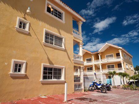 BAVARO, PUNTA CANA, DOMINICAN REPUBLIC - 4 FEBRUARY 2019: Street with apart hotel. Traditional caribbean buildings
