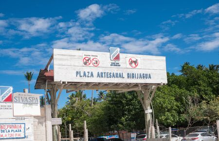 BAVARO, PUNTA CANA, DOMINICAN REPUBLIC - 4 FEBRUARY 2019: Entrance with signboard to Playa and Plaza Artesanal Bibijagua