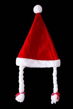 Female santa hat with plaits on black background. Christmas celebration 写真素材