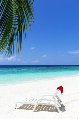 Santa hat on chair. Christmas holidays, travel destinations concept.