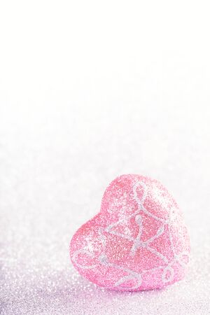 Valentines Day background. Heart shape on glitter bokeh with copyspace, nobody