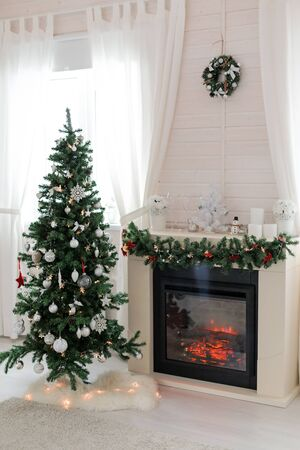 Scandinavian interior of living room with fireplace decorated for Christmas holidays, greeting card, nobody 版權商用圖片