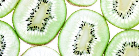 Kiwi cutted slices background, closeup macto texture