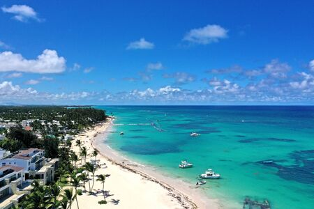 Dominican Republic coastline with resorts, palm trees and ocean. Travel destinations Punta Cana, caribbean vacations, aerial view