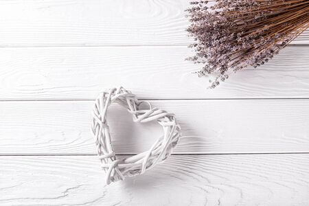 Heart shape and lavender branch on wooden rustic background. Valentines day celebration. Love card with copy space Stock fotó