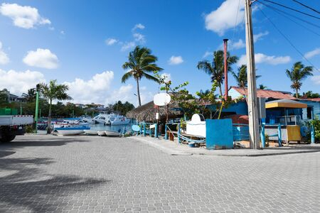 Caribbean town with coast and speedboats. Tropical destinations. Summer holidays