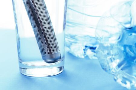 Alkaline Purifier steel filter stick in glass for ionized, energized and structured water with negative potential for healh care. Helps alkalize, hydrate and detoxify human body.