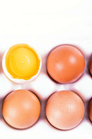 Fresh chicken eggs in white box, closeup and top view, copy space for text