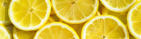 Lemon slices closeup, macro food summer background, fruits top view