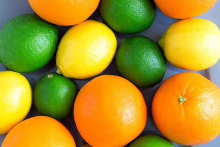 Citrus fruit background, a lot of lemon, orange and lime top view, medicine and food concept