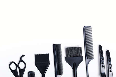 Hairdressing tools with copy space, combs and bleach brushes on white background, top view and flat lay