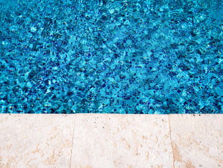 Edge of swimming pool, nobody. Travel concept. Summer vacations