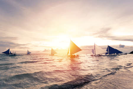 Sailing boats floating in tropical sea. Sunset time. Travel destinations. Summer vacations Reklamní fotografie - 153664297