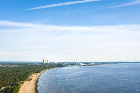 Smoking cooling towers at nuclear power plant near sea ,. Aerial view from drone Reklamní fotografie - 153664312